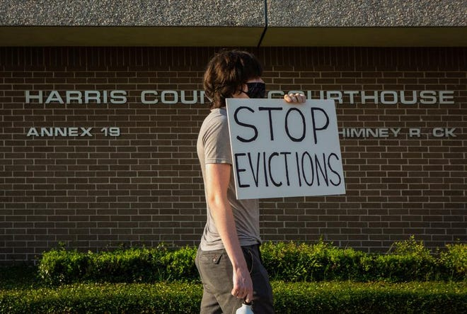 A protester demonstrates outside the Harris County Courthouse in Houston. Credit: