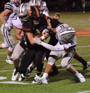 Waverly's Jace Hurd runs the ball during the Tigers' 36-35 Week 1 against visiting Granville.