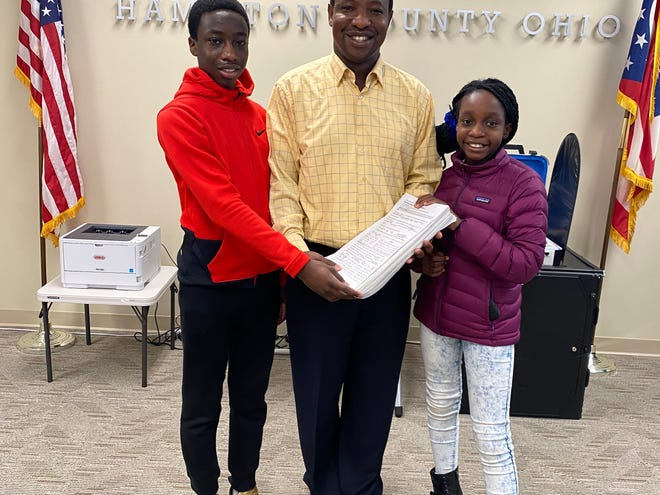 Hamilton County commissioner candidate Herman Najoli and his two children at the Hamilton County Board of Elections.