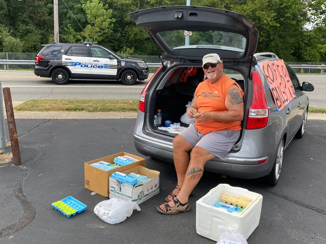 """Chuck Osso of Fairfield sells golf balls out of egg cartons across the street from Huffman Park in Fairfield, outside of Cincinnati. He says Trump supporters still hear echoes of Hillary Clinton's """"deplorable"""" comment in the 2020 election."""