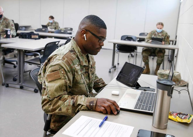 Terrance Hill, a member of the Iowa National Guard, speaks with a potentially COVID-19-positive caller while doing contact tracing on Thursday, Sept. 3, 2020, at Camp Dodge in Johnston.