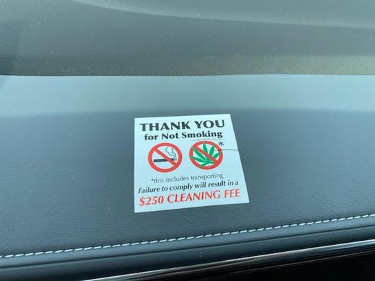 A reminder on the dashboard of a loaner car at Sellers Buick GMC in Farmington Hills to not smoke cigarettes or marijuana inside the vehicle.