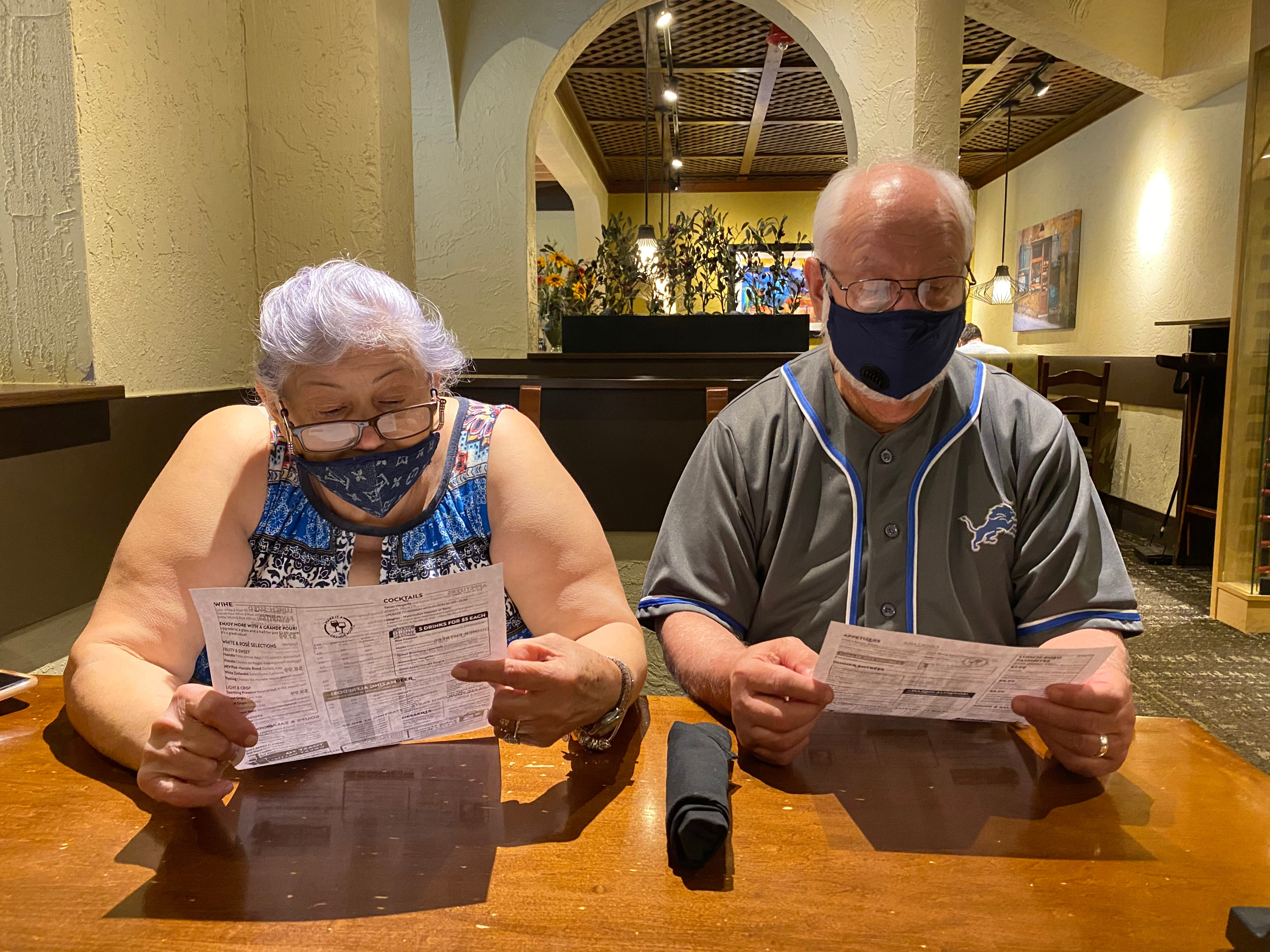 My grandparent's Sanjuana Alvarez and Esau Alvarez, both 67, of Melvindale look at the menu at Olive Garden in Southgate after I took them there because my grandmother wanted to eat pasta on July 18, 2020. Since the coronavirus pandemic a lot of things changed to keep people safe. We were wearing masks, seated apart from other people, three to four tables apart and were given paper menus. This feels so different than before the pandemic.