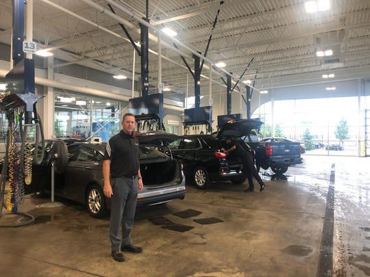 Paul Zimmermann, director of sales for Matick Automotive stands in Matick Chevrolet's detailing center where technicians have to use machines to get smoke smell out of used cars.