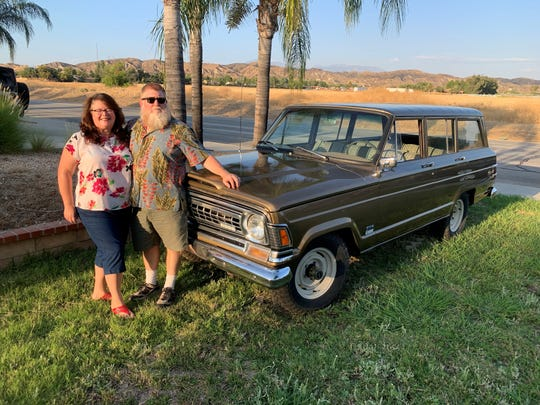 Chuck Berringer, 57, of Marino Valley, California, and his wife with their 1971 Wagoneer.