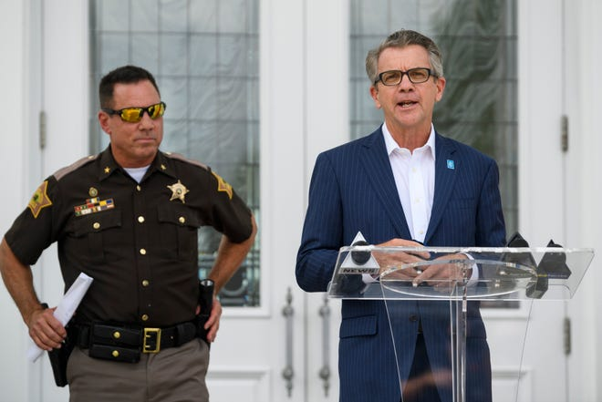 Mayor Lloyd Winnecke, right, thanks people for gather to listen to Vanderburgh County Sheriff Dave Wedding, left, announce his official switch to the Republican Party outside of White Stallion Energy in Evansville, Ind., Thursday afternoon, Sept. 3, 2020.