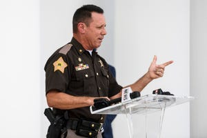 Vanderburgh County Sheriff Dave Wedding announces his official switch from Democrat to Republican while talking to a large crowd outside of White Stallion Energy in Evansville, Ind., Thursday, Sept. 3, 2020. He accused his former party of endorsing flag burning, failing to acknowledge God and not supporting police.