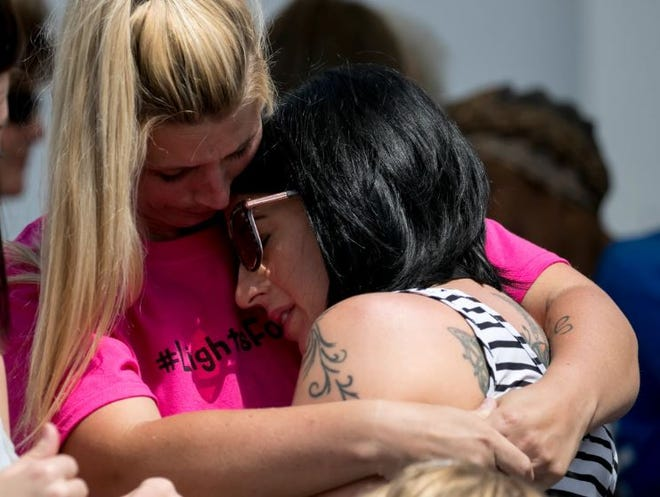 Randi Romanoff hugs the mother of Layla Aiken,  Kathleen Redmond,  at the Lights for Layla fundraiser on Saturday, March 30, 2019, in Cape Coral. Romanov helped organize the event to raise money and awareness for safer bus stops after  Layla was killed. Cape Coral police arrested Romanoff this week after the State Attorney's Office charged her with the theft of money from the event.