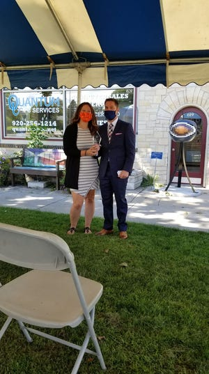Quantum PC Services Founder Nathan Drager and Executive Vice President Erin Helgeson hold their award for Rural Small Business of the Year granted by the U.S. Small Business Administration.
