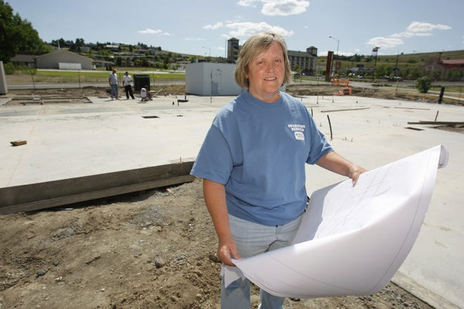 """Deb Hudson, owner of the Golden Corral, stands with the blueprints of the restaurant in 2009 when it was being rebuilt after a fire destroyed the building. The popular restaurant was unable to bounce back from COVID-19. """"We weren't getting the sales increase we needed to get,"""" Hudson said."""
