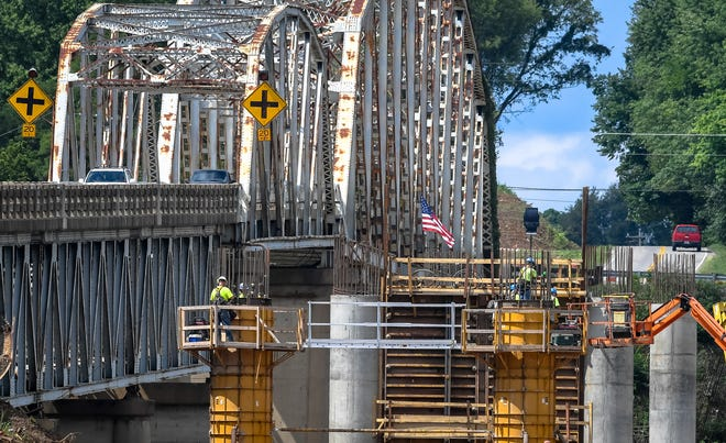 Workers pour concrete on one of the rising piers for the new $32,215,900 Spottsville Bridge crossing the Green River on U.S. 60 Thursday, September 3, 2020.