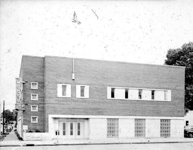 Moose Lodge #732 building at Second and Green streets, apparently during the early 1950s not long after it was constructed in 1950, although the lodge had been considering a new building since 1945. The building was erected on the site of an older house that the Moose had used since 1916. The local lodge was incorporated Aug. 20, 1913, and at first used the top floor of the building at the southeast corner of First and Elm streets, although it used several other locations before settling in at Second and Green.