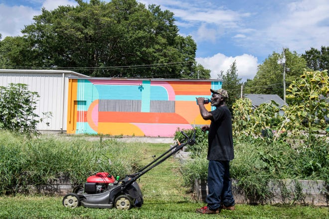 Volunteer at RIFA takes a moment to drink a Powerade just as he was working on mowing the lawn in community garden in the hot afternoon in Jackson, Tenn., Thursday, Sept. 3, 2020.