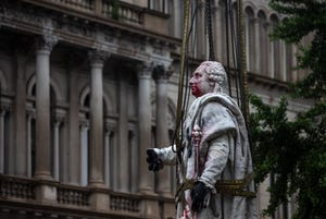 The statue of King Louis XVI is removed from the front of Louisville Metro Hall after being vandalized during recent protest in the city. Sept. 3, 2020