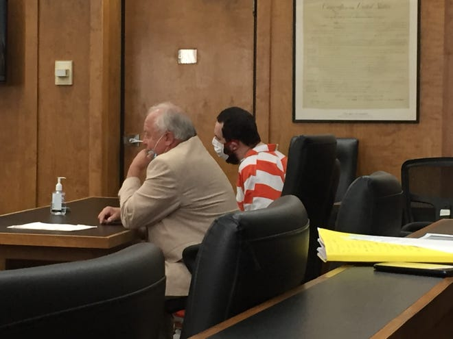 Mark Ramsey sits at the defense table with attorney Bernie Davis while being sentenced Thursday in Richland County Common Pleas Court.