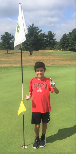 Dawson Dreibelbis, 10, of Lexington had a hole in one at Forest Hills Golf Course last week