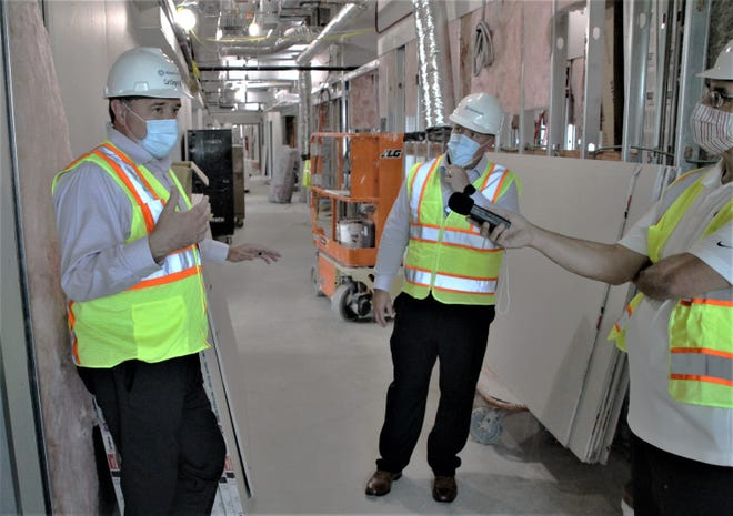 Marion General Hospital Chief Operating Officer Dr. Curtis Gingrich, left, talks with local media members during a tour of the hospital's new addition on Wednesday, Sept. 2, 2020. The 60,000-square foot facility is scheduled to open to patients on Jan. 12, 2021. Also pictured are Justin Hamper, center, administrative director clinical operations/operations administration at MGH, and Paul James, right, of iHeartMarion.