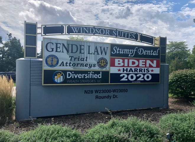 A condominium association wants a Pewaukee business owner to remove a Biden/Harris 2020 sign.