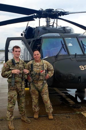 U.S. Army Chief Warrant Officer Dave Corbi of Johnstown (right) and his son, Sgt. David Corbi (left) are shown prior to their Father's Day flight together this year.
