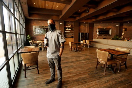 Anthony Bucco, of Felina Bar & Restaurant, poses for a photograh in the new dining room layout, in Ridgewood. The tables, which are further apart will be able to be filled with customers starting Friday.  With the new guidelines, restaurants can only have 25% of the customers they had before the pandemic.  Thursday, September 3, 2020