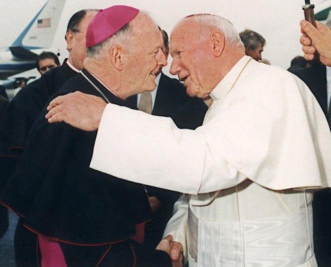 Then-Archbishop Theodore McCarrick, left, is seen with Pope John Paul II in Newark, N.J., in this October 1995 file photo. McCarrick was named cardinal  Jan. 21, 2001. (AP Photo/Arturo Mari)