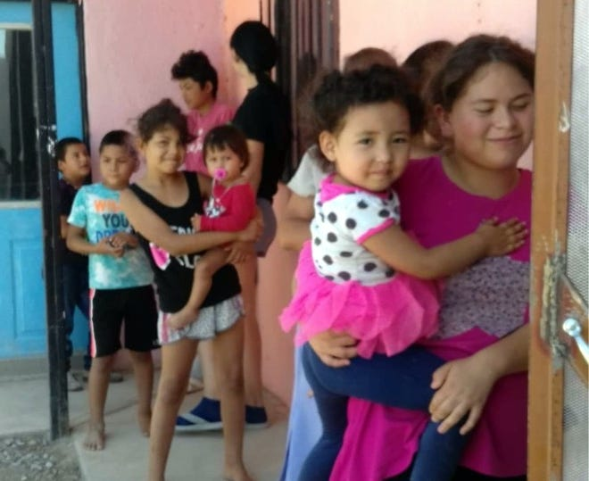 Families and children line up outside the Community Kitchen for hand-out meals in Palomas, Chih. Mexico.