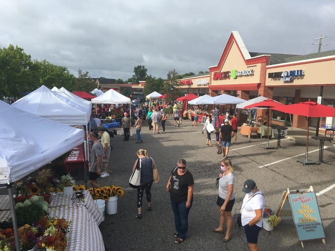 Shoppers spread out on Market Street to check out the farmers' fresh goods.