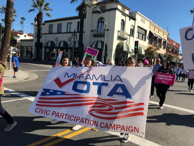 Members of Mi Familia Vota march in Riverside, spreading the importance of civic participation and voting, in January 2020.