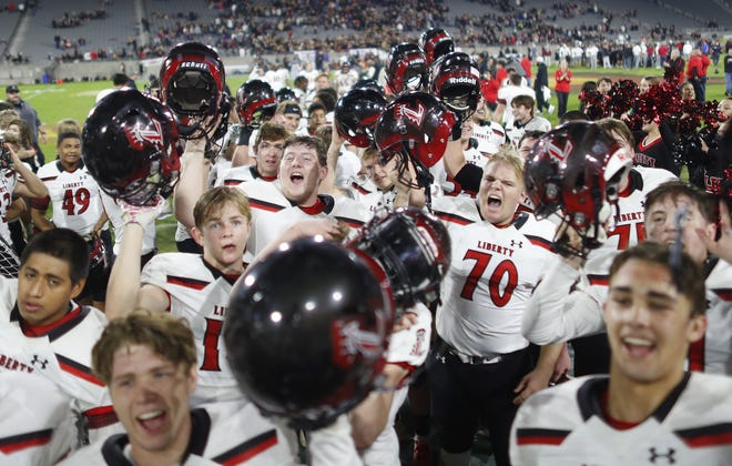 Liberty celebrates winning the 6A State Championship over Red Mountain in overtime at Sun Devil Stadium in Tempe, Ariz. on Dec. 6, 2019.