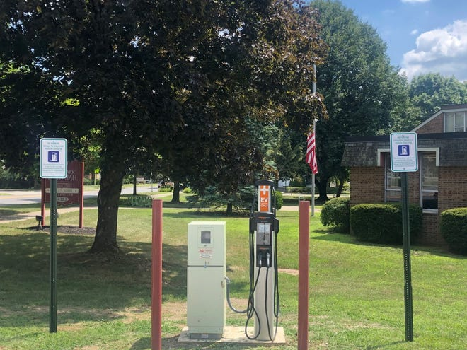 An electric vehicle charging station is located in the parking lot of Hyde Park's Town Hall.