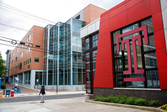 FILE — This May 23, 2019 file photo shows Temple University in Philadelphia. Amid rising numbers of positive coronavirus cases, Temple University announced Thursday, Sept. 3, 2020,  that the majority of classes will shift to online through the end of the semester.(AP Photo/Matt Rourke, File)