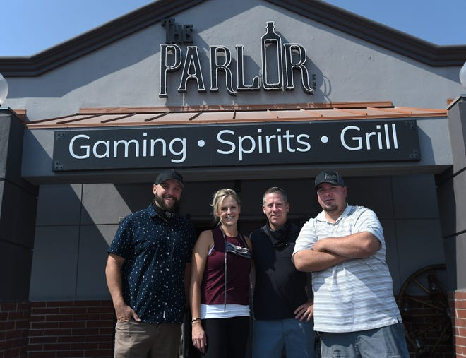 The owners of the Parlor, left to right, Steven Chimarusti, Marissa Tolotti, Jason Tolotti and Justin Moscove, take a moment in front of the the new restaurant in South Reno on Sept. 3, 2020.