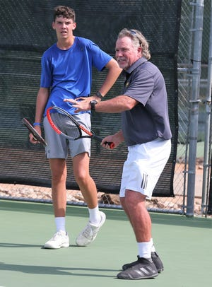 Bentwood Country Club's Kevin Collins gives a tennis lesson to Wall High School sophomore Payne Smith. Collins, a longtime Bentwood pro, is one of nine finalists for the National United States Professional Tennis Association (USPTA ) Industry Excellence Award.