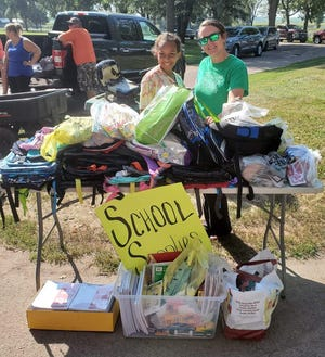 Sylea Sykes (left), a vendor at the Dell Rapids Farmers Market, and Jennifer Mason at the Aug. 21 Farmers Market collecting school supplies.
