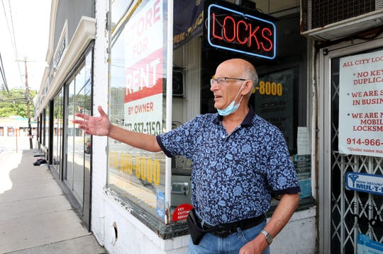 Paul Feiner, the Greenburgh Town Supervisor, talks about the storefront vacancies on each block of the four corners in Hartsdale, like this locksmith on East Hartsdale Avenue, Sept. 3, 2020.