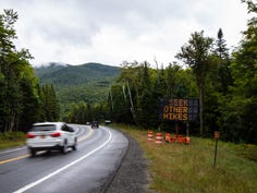A sign on State Route 73 flashes two messages to drivers: HIKER PARKING LIMITED, SEEK OTHER HIKES. The Cascade Mountain trailhead, about a quarter mile down the road, is often overflowing with cars and the mountain might see 400-500 hikers on a weekend day.