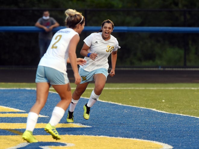 Ava Van Reeth, left, is congratulated by senior Lola Ramos after scoring with 16 seconds left before halftime against host Maysvile on Wednesday. Van Reeth's goal was the only goal of the game.