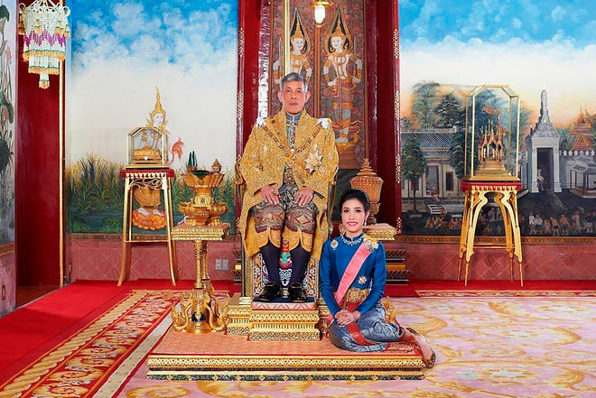 This undated file photo posted on Aug. 26, 2019, on the Thailand Royal Office website shows King Maha Vajiralongkorn with Major General Sineenatra Wongvajirabhakdi, the royal noble consort. Thailand's king has reconciled with his royal consort, whom he stripped of her titles in 2019 after accusing her of seeking to undermine his official wife, the country's queen.