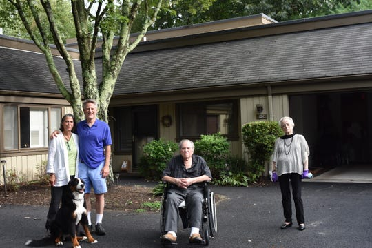Michael Subit and wife Leslie Hagin stand with dog Breezy, Michael's father Larry Subit and his ex-wife, Marlene Subit in Somers, New York. Michael hadn't seen his parents together in nearly 30 years.