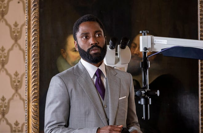 "John David Washington stars as The Protagonist in Christopher Nolan's ""Tenet."""
