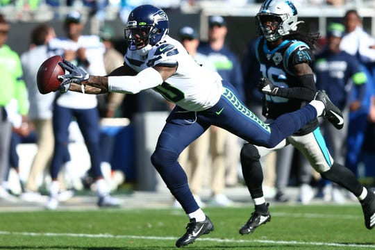 Seattle Seahawks wide receiver Josh Gordon (10) catches a pass against Carolina Panthers cornerback Donte Jackson.