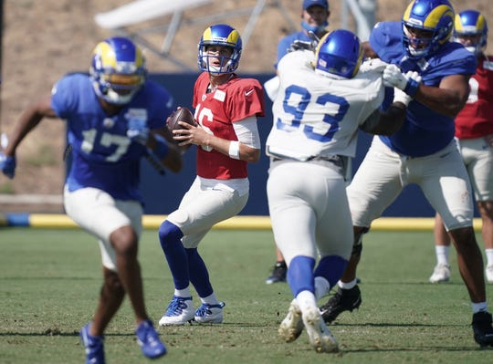 Los Angeles Rams quarterback Jared Goff, 16, throws the ball during training camp at Cal Lutheran University.