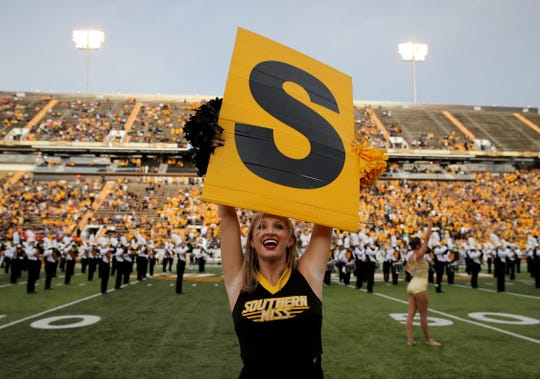 A Southern Miss cheerleader performs before the school's game against the Savannah State at M.M. Roberts Stadium.