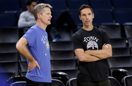 Steve Nash, shown talking with Warriors coach Steve Kerr, was named the head coach of the Brooklyn Nets on Thursday.