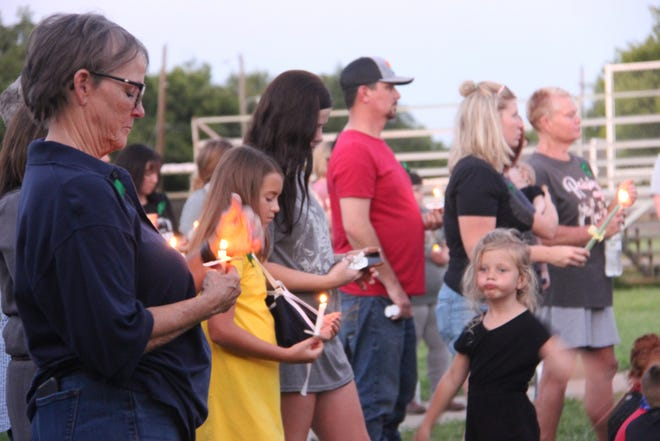 Community members from Lone Grove and across Carter County lit candles Thursday night as they prayed for three local children still fighting for their lives.