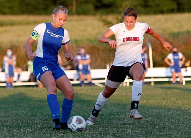 Northwestern's Brianna Troyan (15) works against Crestview's Mary Leeper (14) during high school girls soccer action on Thursday night at  Northwestern High School. The Huskies won, 2-0.
