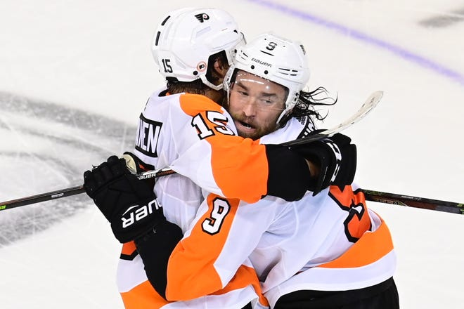 Flyers defenseman Ivan Provorov, right, celebrates his winning goal with Matt Niskanen in the second overtime of Game 6 against the Islanders on Thursday night.