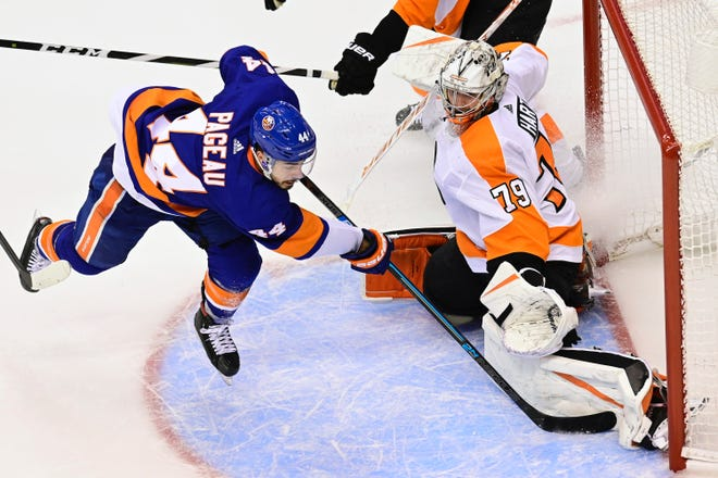 Philadelphia Flyers goaltender Carter Hart (79) stops New York Islanders centre Jean-Gabriel Pageau (44) during overtime period NHL Stanley Cup Eastern Conference playoff hockey action in Toronto on Thursday, Sept. 3, 2020. THE CANADIAN PRESS/Frank Gunn