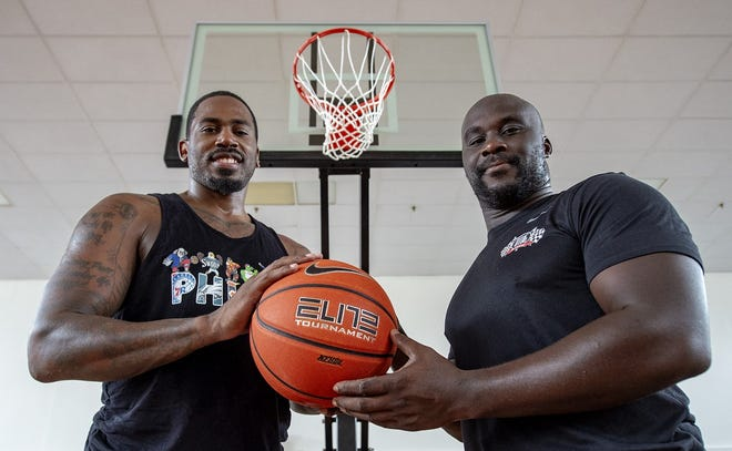 Friends and athletes Tayron Thomas, left, and D'Andre Webb are opening the gym in the former Delhaas High School, now an office complex on Route 413 in Bristol Township, as a recreation center for local children.