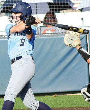 Allee Erne takes a big hack during recent Bartlesville High School varsity softball action at the Lady Bruin Complex.